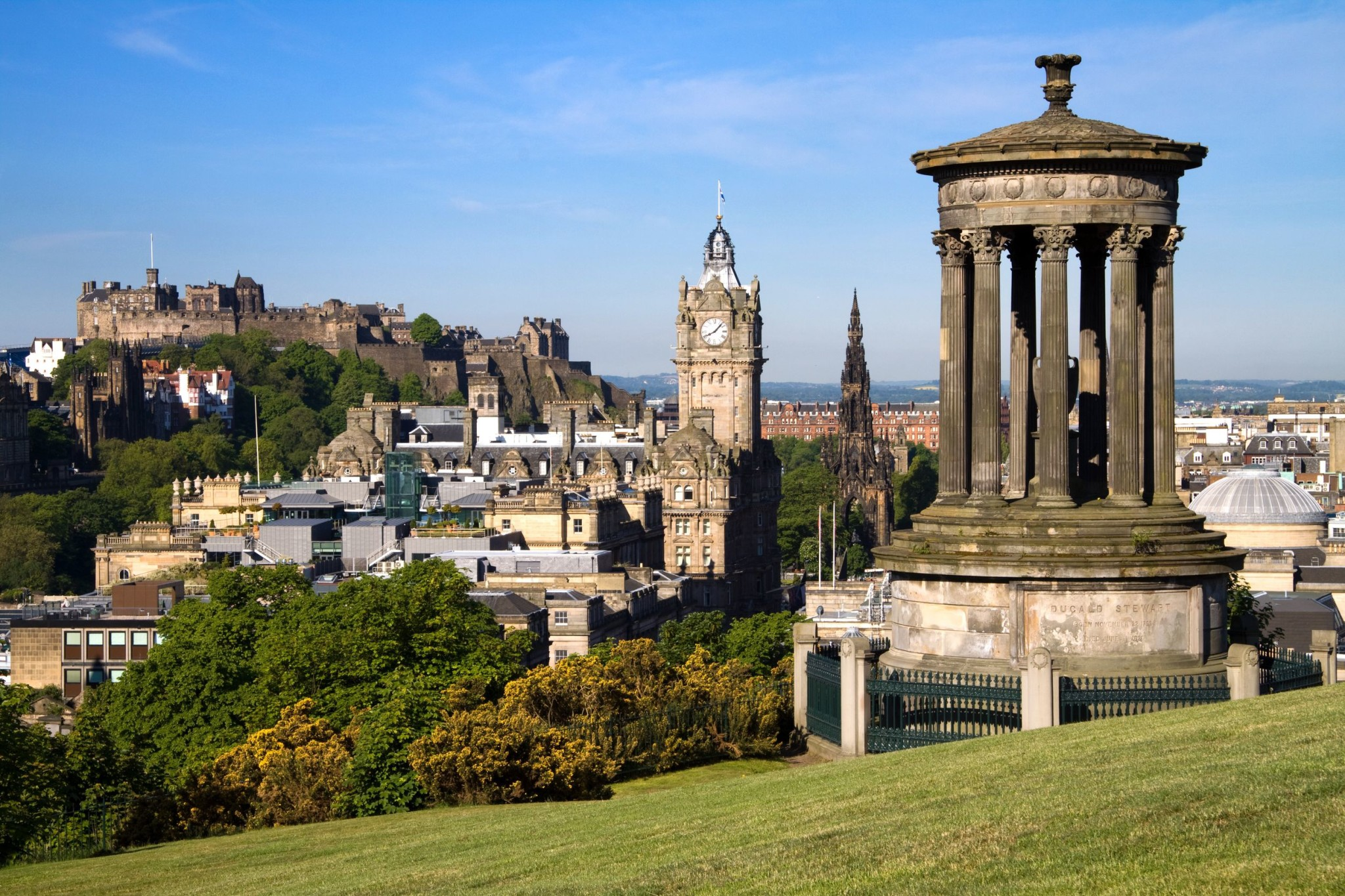 Edinburgh Scotland view from Calton Hill with the Dugald Stewart monument, Scott monument and Balmoral clock tower